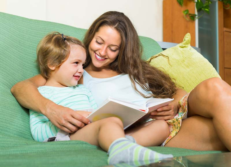 parents and children reading books together